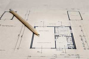 Architect plans with a pencil on them