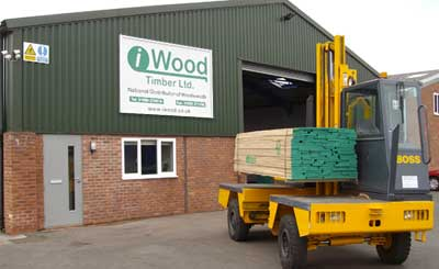 A picture of the side loader outside the iwood timber merchants building